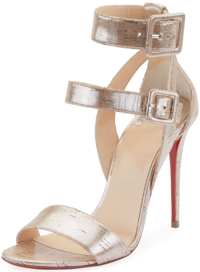 Covered square buckles cinch the tiered straps of a shapely sandal lifted by a slender stiletto