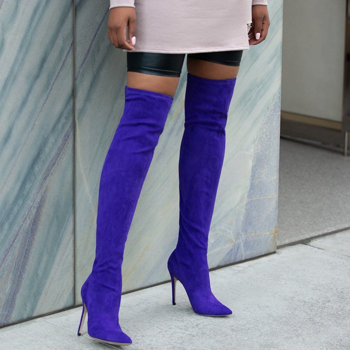 Sexy thigh high stiletto heeled bootie with a pointed toe and back zipper closure