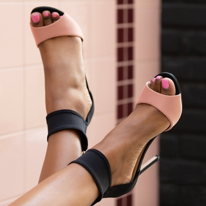 A dressy neoprene heeled sandal with a statement ankle cuff and back zipper closure