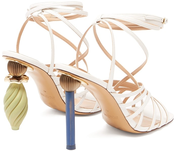 First seen in the Riviera-inspired SS19 runway show, Jacquemus's white leather Pisa sandals feature mismatched ornaments like wearable pieces of art