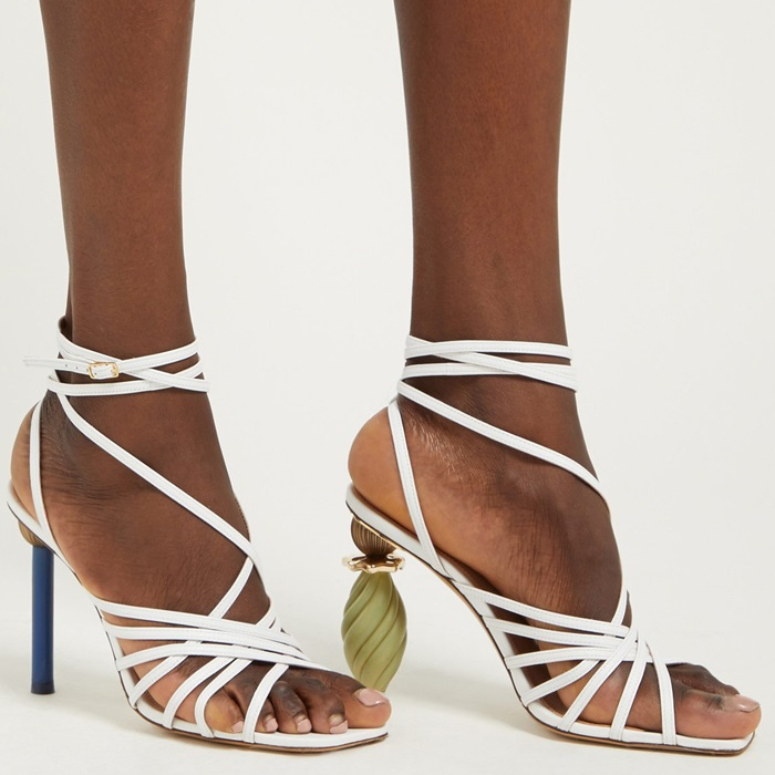 The artfully proportioned pair has been crafted from smooth white leather and comprises slender strappy uppers, squared toes, and the mismatched heels that have become synonymous with the brand's shoe designs