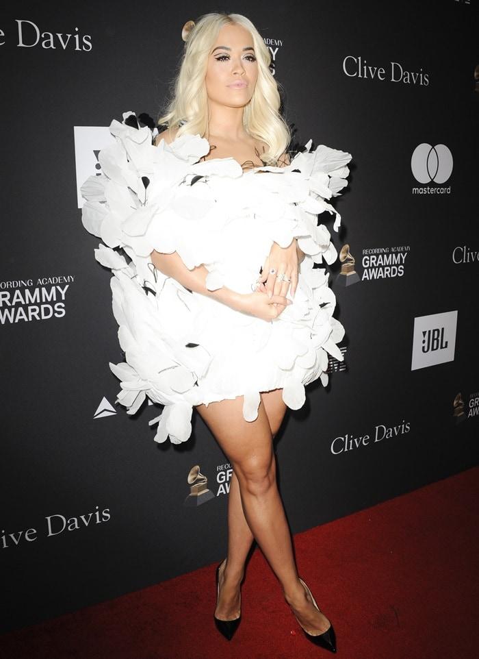 Rita Ora flaunted her hot legs in a white Yanina dress