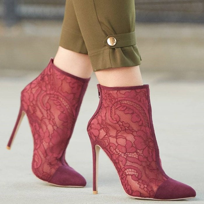 A lace detail ankle bootie with a stiletto heel, cap toe, and back zipper closure