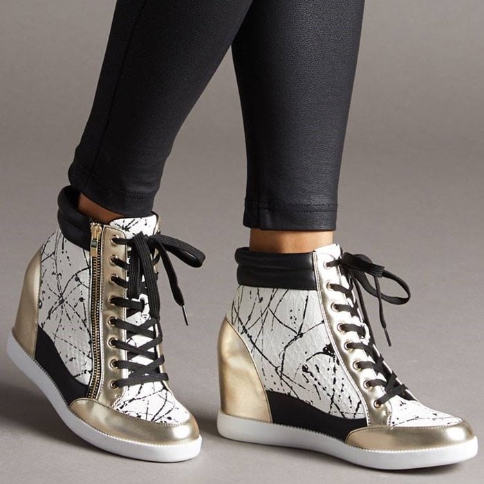 A street style wedge sneaker with functional outer zipper detail and adjustable front laces