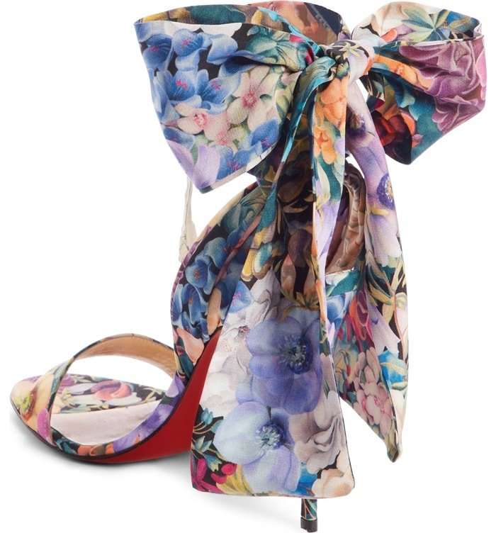 Romantic blooms enliven an elegant sandal crafted from luxurious silk with wide, scarflike straps that wrap around and tie at the ankle