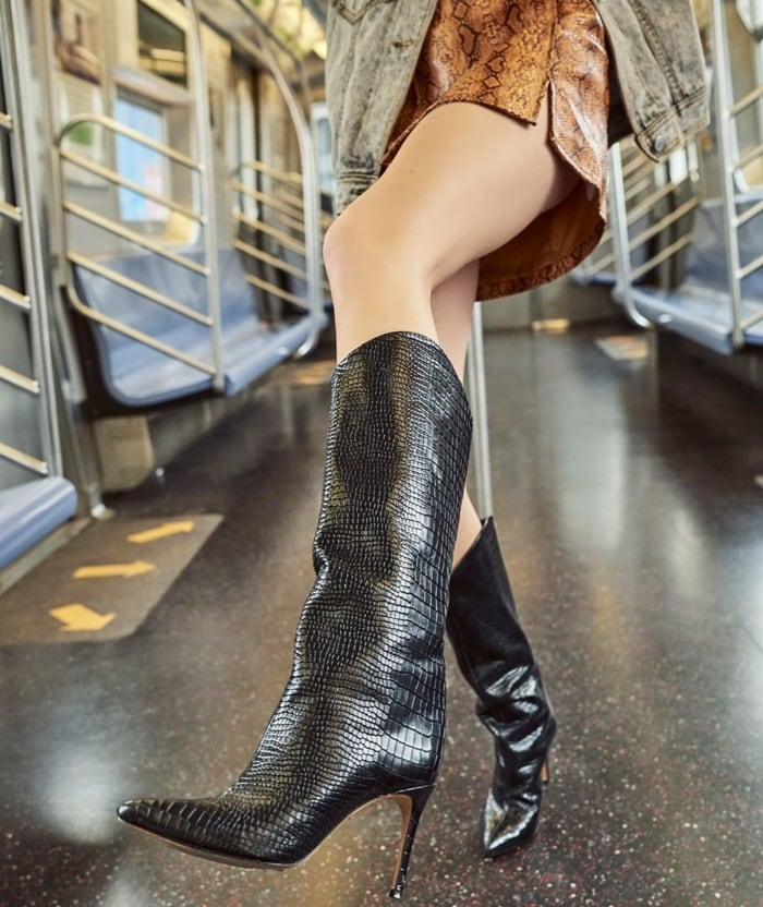 Embossed leather adds a touch of southwestern style to a pointy-toe boot lifted by a slimmed-down heel