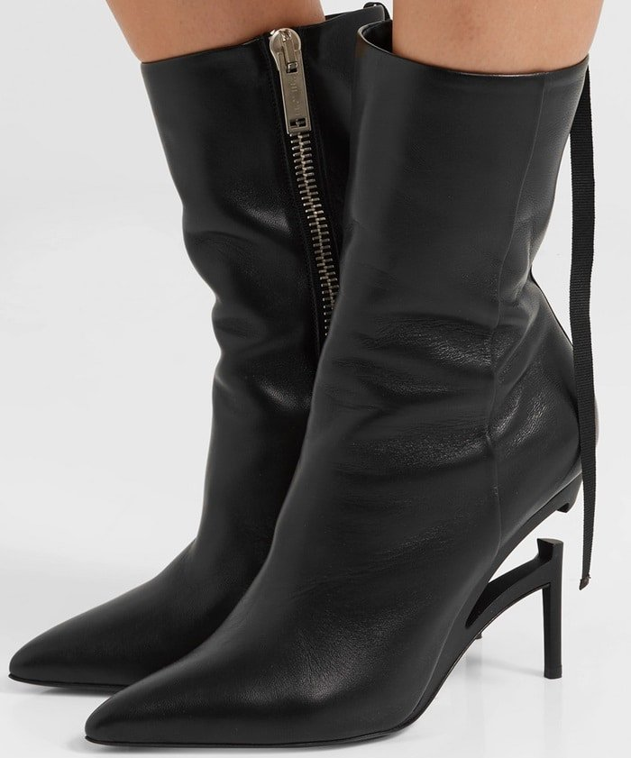Made in Italy from smooth black leather, they rest on a signature broken heel and have a sleek pointed toe.