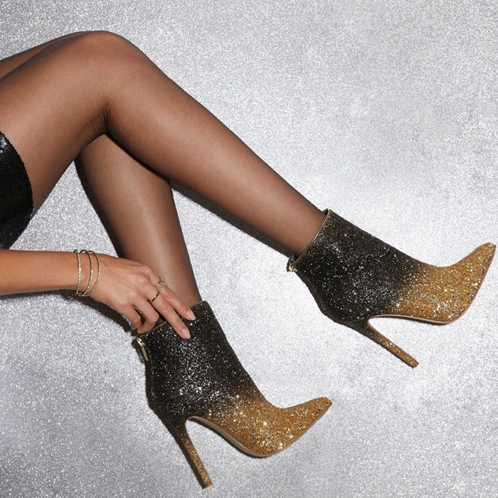 Chic ankle bootie featuring a pointed toe, stiletto heel, and back zipper closure