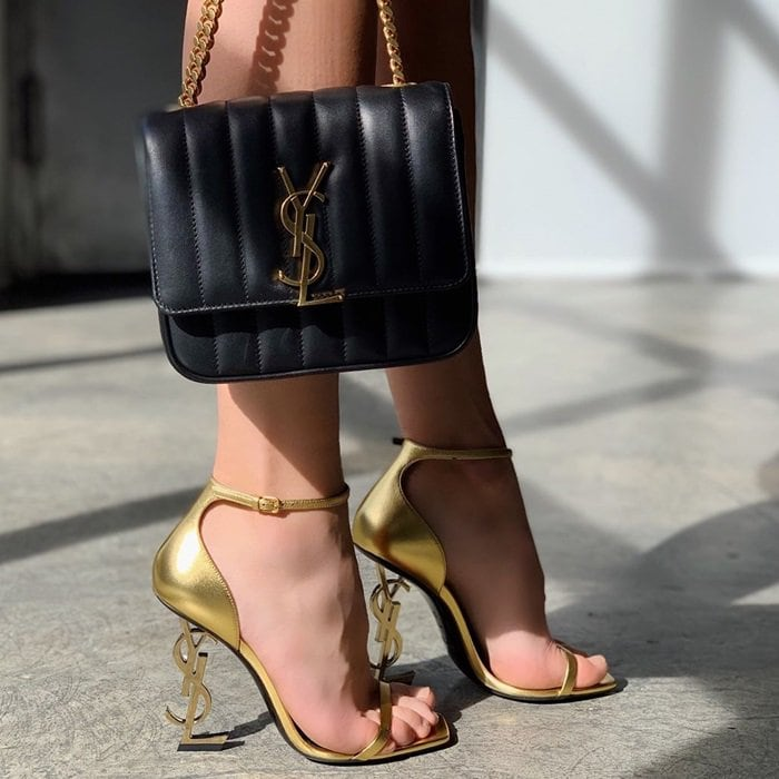Gilded sandals and leather crossbody bag by Saint Laurent