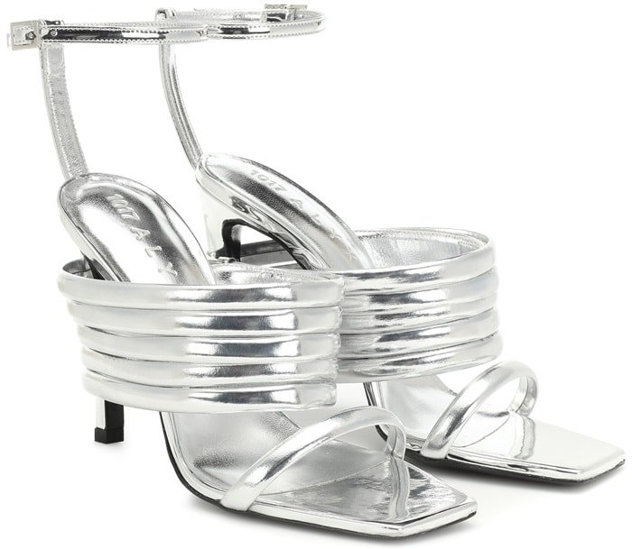 These high-shine metallic silver leather sandals are set on a high coated heel and have a square-toed silhouette, while the thick ridged strap gives them their unique look