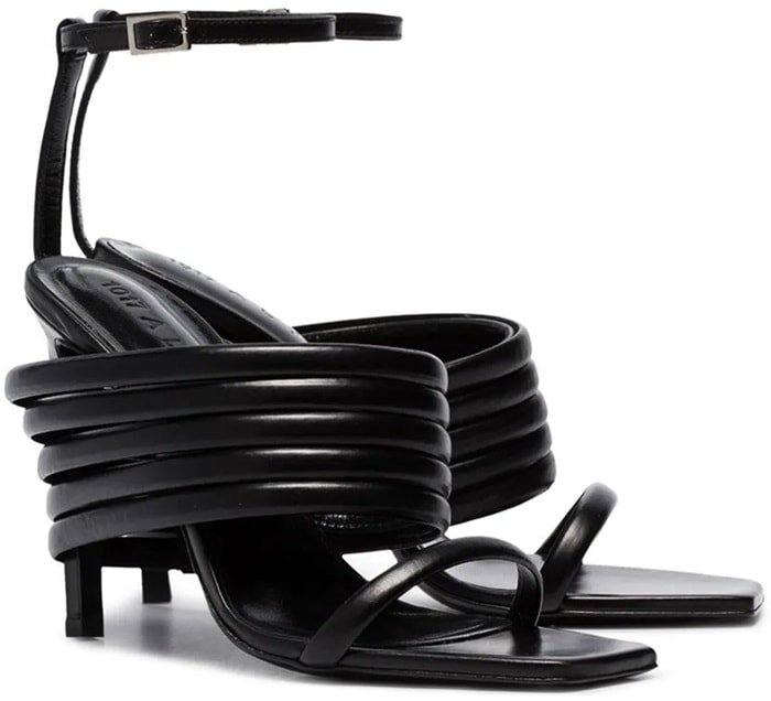Crafted from leather, these black Tunnel 100 strappy sandals feature an ankle strap with a side buckle fastening, an open toe, a high stiletto heel with wrap-around straps and a leather sole