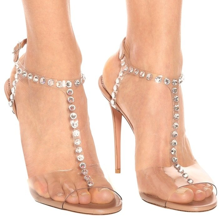 Aquazzura's 'Shine' sandals are embellished with crystals along the PVC T-strap, creating the illusion of glistening gems on bare skin