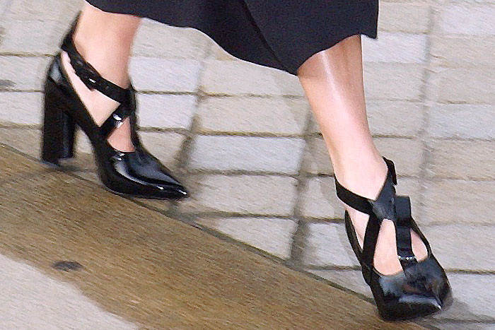 The center t-strap misaligned on one of Alicia Vikander's Louis Vuitton crisscross-strap patent pumps