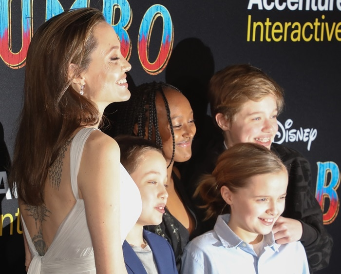 Angelina Jolie showed off her back tattoo in an open back dress