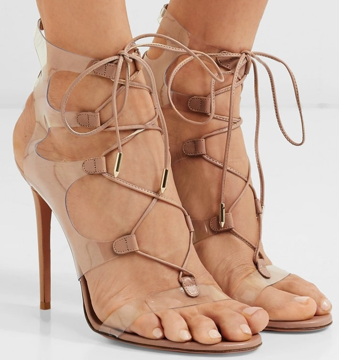 These blush sandals take this season's barely-there trend to new heights - they're made from transparent PVC so it looks like the laces are floating