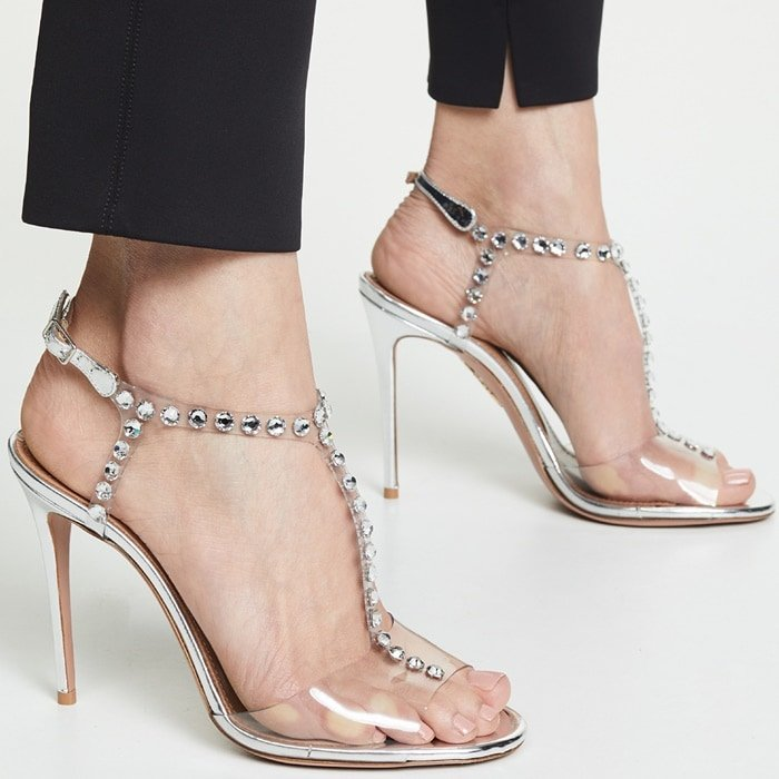 Expertly made in Italy from metallic leather, this pair rests on a slim stiletto heel for a leg-lengthening effect, while the adjustable ankle strap ensures a secure fit