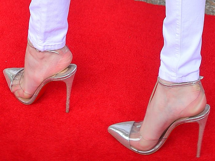 Details of the Christian Louboutin 'Nosy' PVC t-strap pumps on Bella Thorne