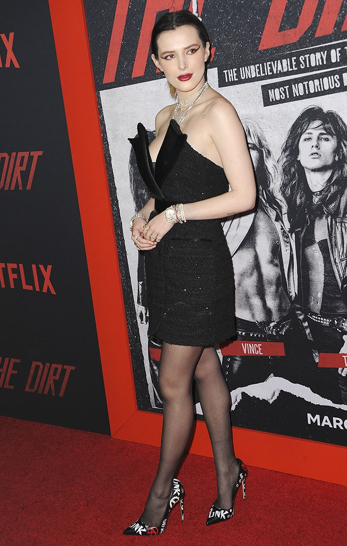 Bella Thorne wearing a black strapless coat dress featuring shaped black satin lapels