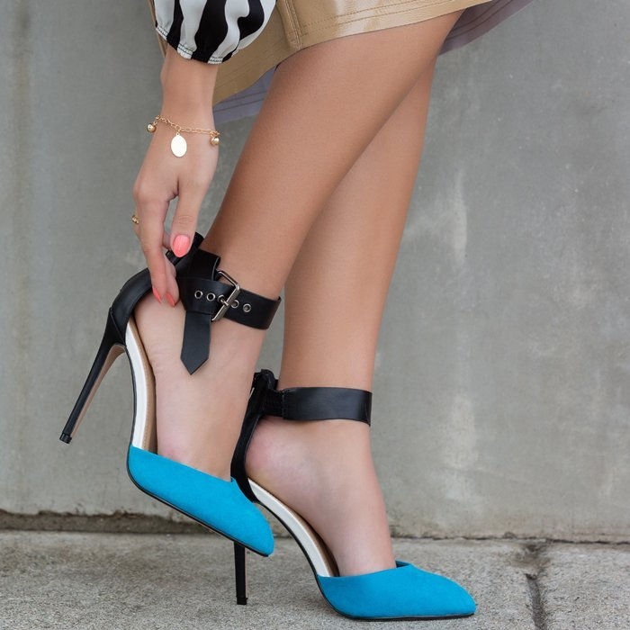 A stiletto pump featuring a pointed toe and a knotted belt with grommets detail