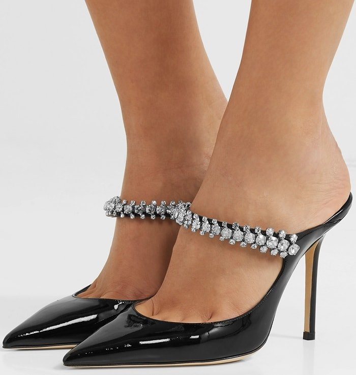 They're made in Italy with a high stiletto heel and a point toe, then set with a curved arch strap that is frosted with faceted crystals