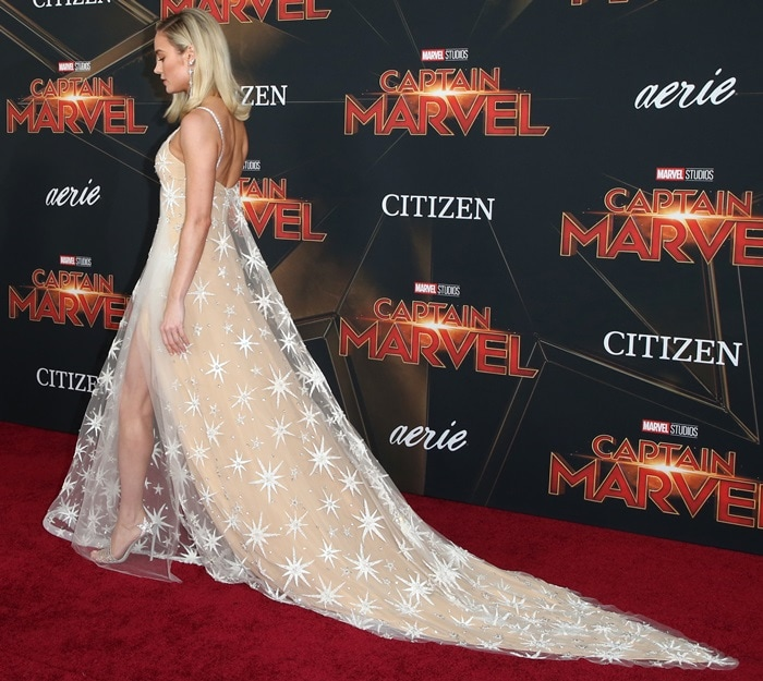 Brie Larson in a custom Rodarte gold gown featuring Captain Marvel's signature white and silver embroidered stars