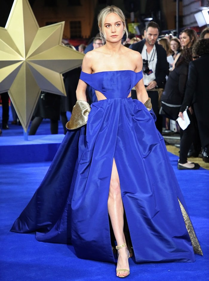 Brie Larson flashing leg on the blue carpet at the European premiere of her anticipated film Captain Marvel held at The Curzon Mayfair in London, England, on February 27, 2019
