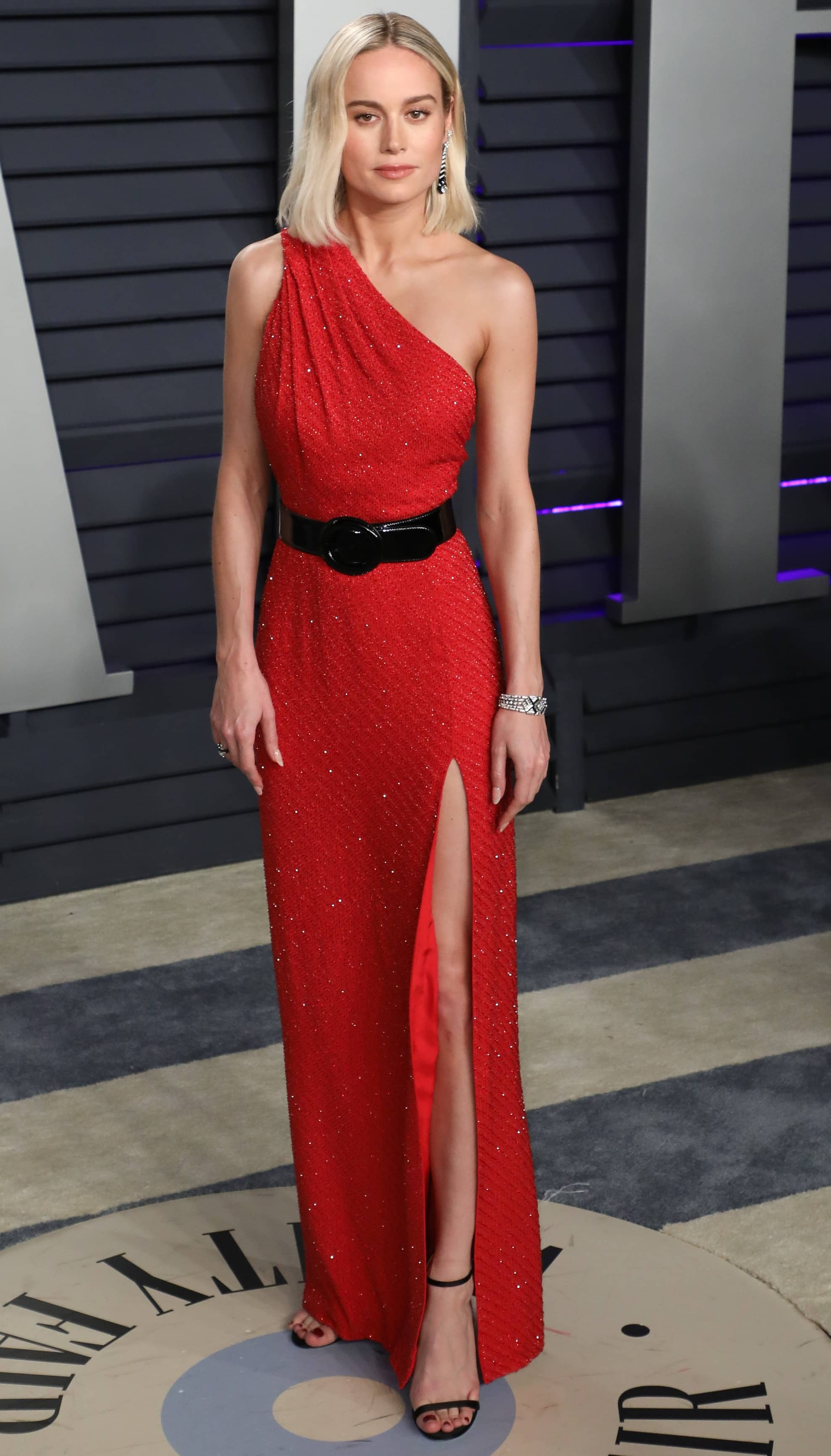 Brie Larson's red one-shoulder bead-embroidered dress at the 2019 Vanity Fair Oscar Party at the Wallis Annenberg Center for the Performing Arts in Beverly Hills, California, on February 24, 2019