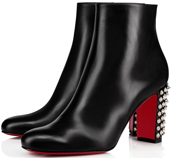 Crafted from black leather, the style features a heel studded with silver-tone spikes, as well as the iconic red outsole.