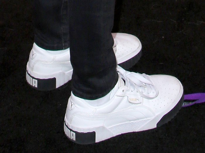 Side view of Cara Delevingne's PUMA 'Cali' sneakers