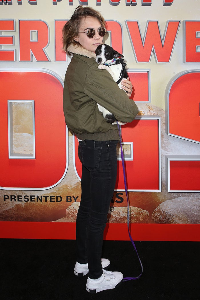"Cara Delevingne bonding with the dogs at Imax's ""Superpower Dogs"" World Premiere at the IMAX – California Science Center in Los Angeles, California, on March 9, 2019"