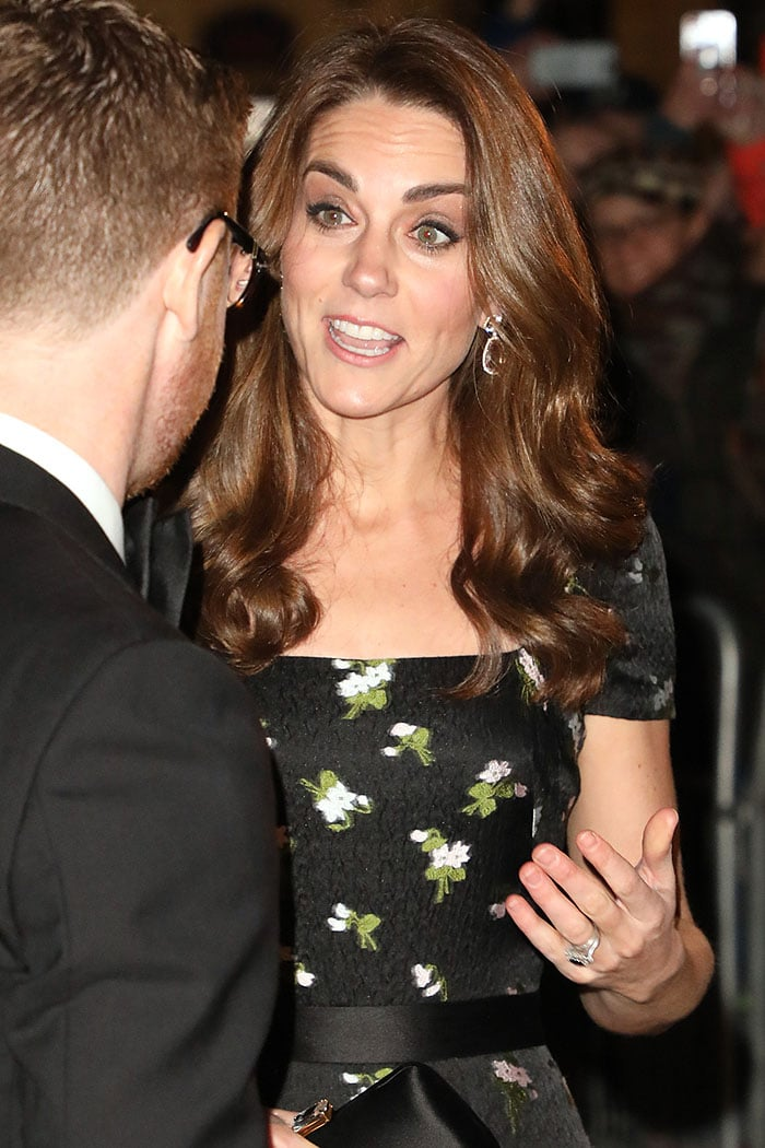 Kate Middleton in her recycled Alexander McQueen dress that she changed up with cap sleeves and a loose waves hairstyle