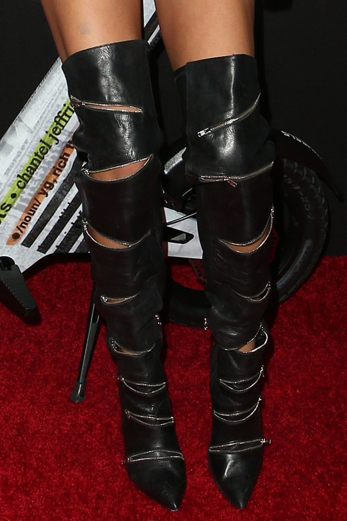 Details of the thigh-high biker boots with multiple zippers on Chantel Jeffries