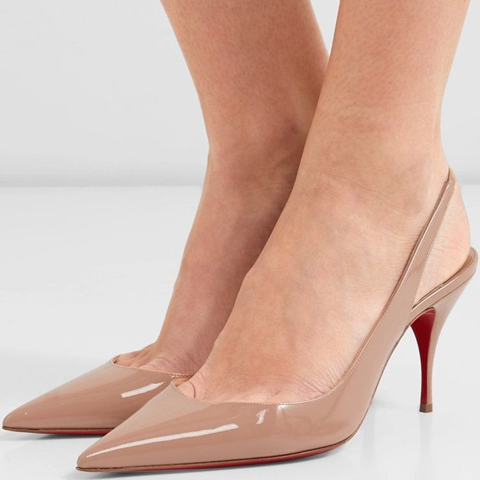 Crafted from high-shine patent-leather, the point-toe silhouette rests on a slim stiletto heel with a slingback strap that has an elasticated band for easy wear