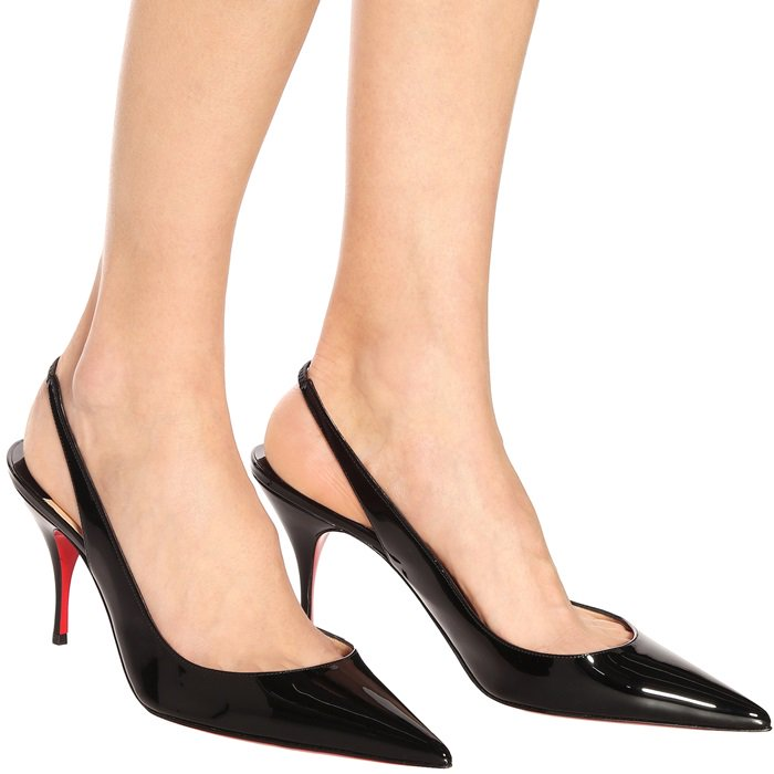Designed to be worn for years to come, this black pair has been made in Italy from glossy patent-leather and lacquered with the designer's iconic red soles