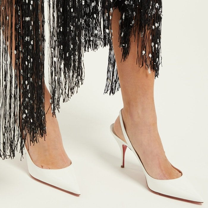 A sharp pointy toe, tapered heel and iconic red sole detail a slingback pump designed for power moves.