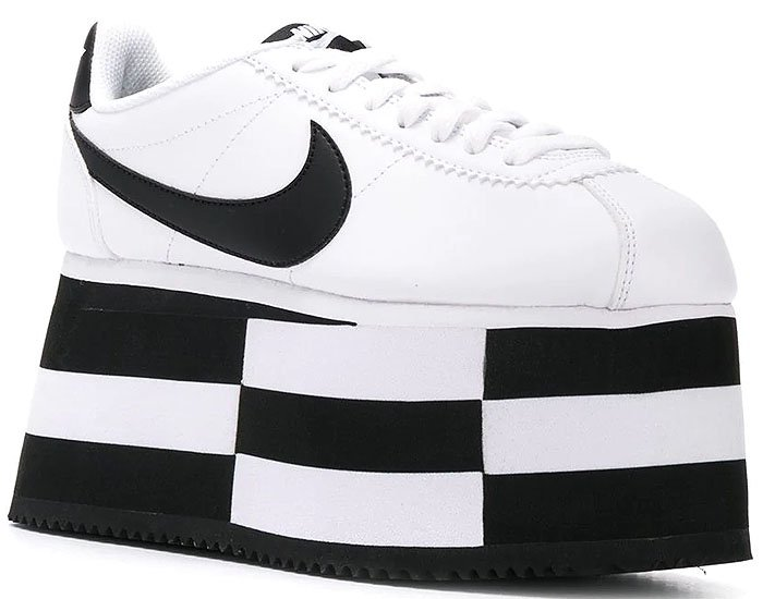 A stylishly striped platform sole gives a literal attitude boost to a sleek sneaker designed in collaboration with iconic sportswear brand Nike