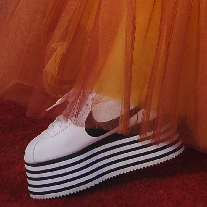 Comme des Garçons x Nike Cortez striped-platform sneakers on YouTube star, Poppy