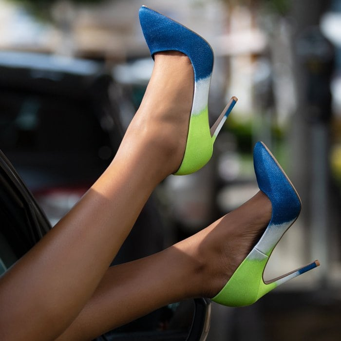 A classic denim slip-on pointed-toe pump with a stiletto heel