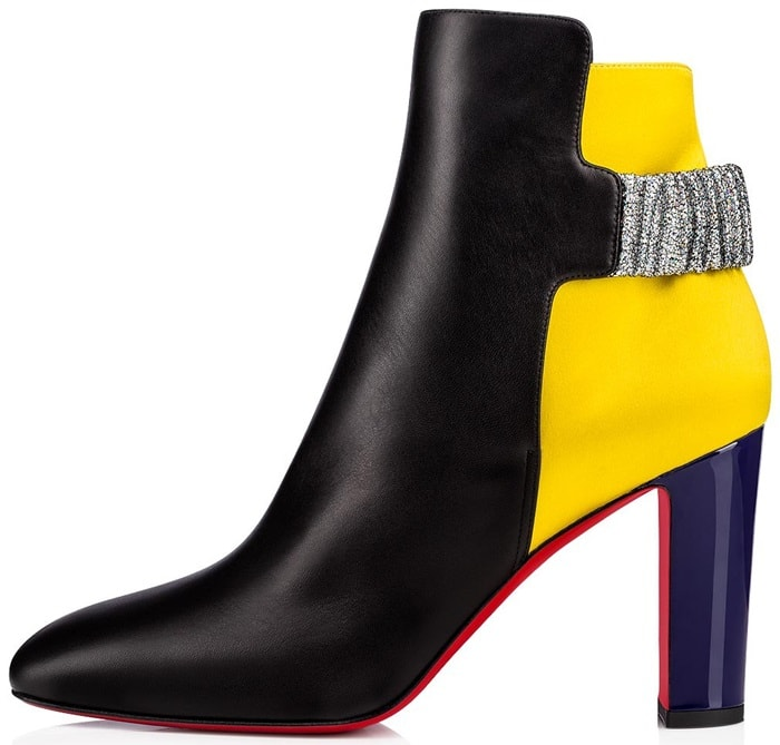 Mounted on an 85mm shiny blue heel, it reveals the iconic details of the Louboutin House with every step