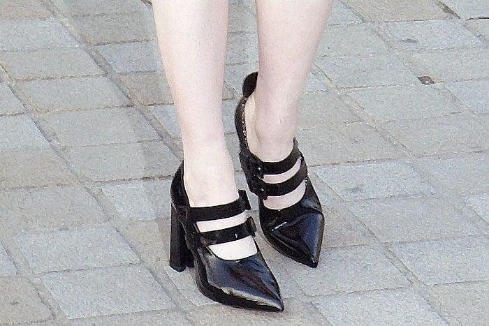 e990e025f66d Closeup of Emma Stone s Louis Vuitton double-strap mary jane patent pumps
