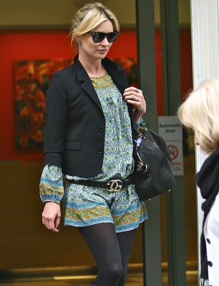 Kate Moss leaves a London clinic in a Gucci belt on March 31, 2009