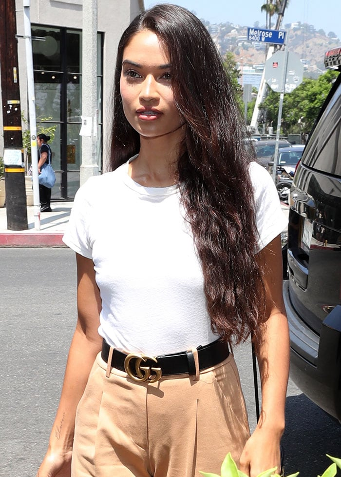 Model Shanina Shaik wears a Gucci belt with wide legged pants in West Hollywood on August 17, 2018