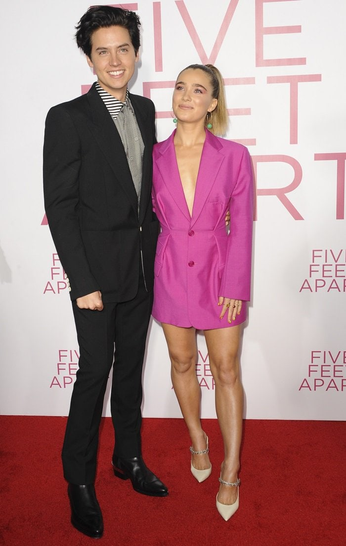 Haley Lu Richardson looked cute in a pink blazer dress while posing with co-star Cole Sprouse at the premiere of their new movie Five Feet Apart in Los Angeles on March 7, 2019