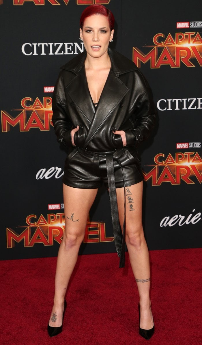 Halsey showed off her random tattoos in a belted playsuit at the premiere of Captain Marvel in Hollywood, California, on March 4, 2019