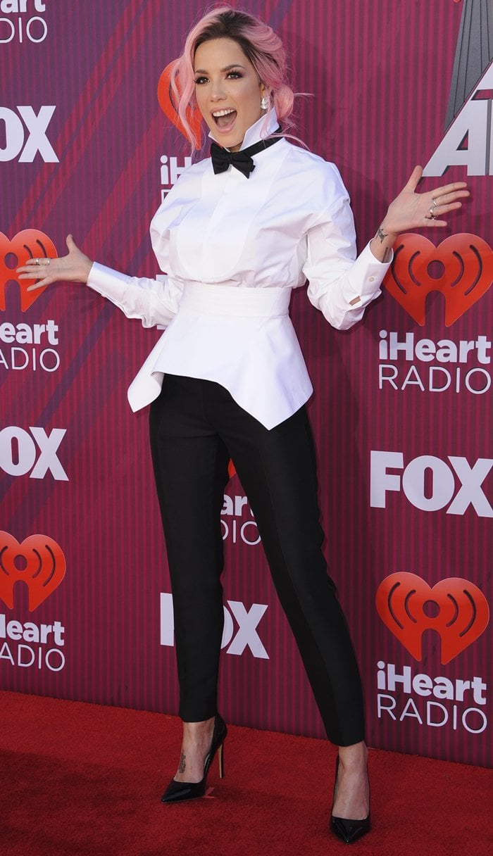 Halsey strikes a pose on the red carpet as she arrives at the 2019 iHeartRadio Music Awards at the Microsoft Theater in Los Angeles on March 14, 2019