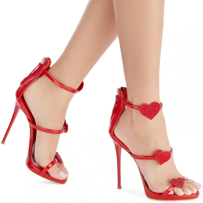 """These sandals are adorned with suede """"Heart"""" embroidery with crystals and detailed with the Giuseppe Zanotti logo on the leather sole"""