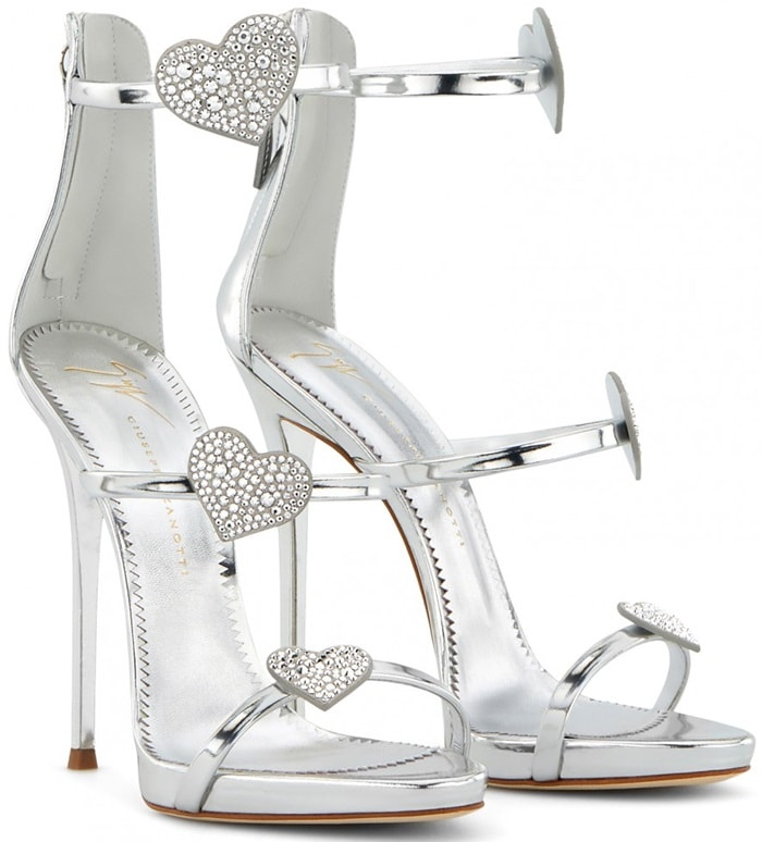 Sparkle and shine for Spring/Summer '19 wearing these silver mirrored leather Swarovski heart sandals featuring multiple front straps, an open toe, a back zip fastening, Swarovski crystal embellishments, a high heel, and a heart pattern.