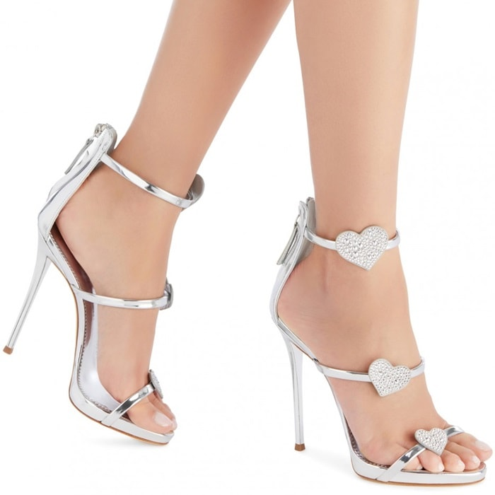 Crafted from silver mirrored leather, these sandals are set on a stiletto heel