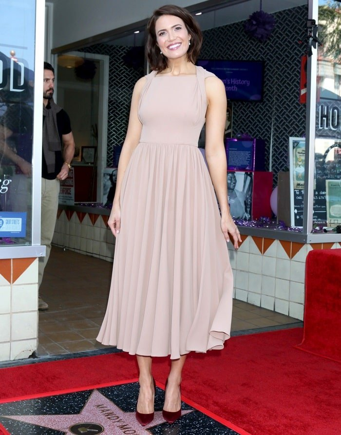 Mandy Moore's nude Emilia Wickstead dress with burgundy Christian Louboutin pumps