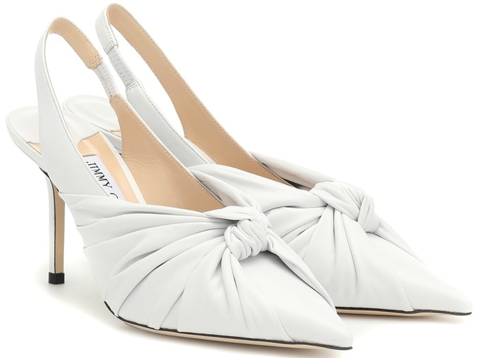 Jimmy Choo's 'Annabell' slingback pumps have been made in Italy from optic white leather and rest on an 85mm heel